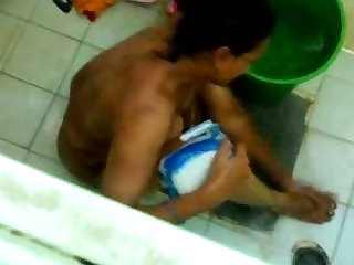 bathing aunty caught in cam