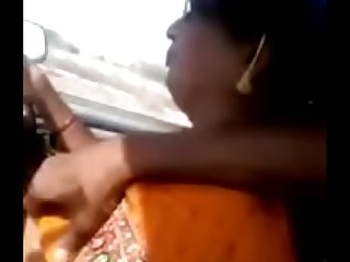TAMIL AUNTY IN CAR FEELING DICK