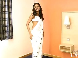 Indian girl in white dress does striptease